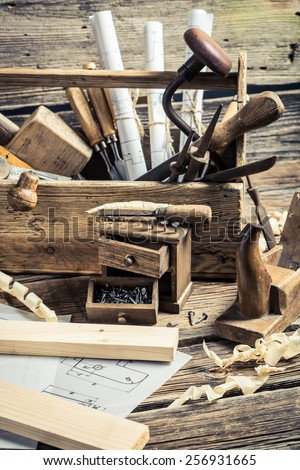 Drafting Tools and diagrams in the carpentry workshop - stock photo