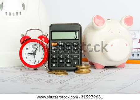 Drafts with piggy bank, coins and yellow pencil, close up view - stock photo