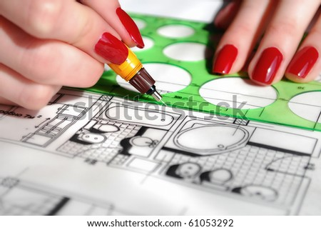 Draftsman drawing a bathroom project - stock photo