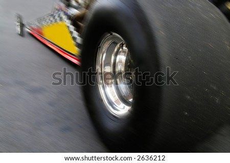 Drag-racing car in motion shot from below