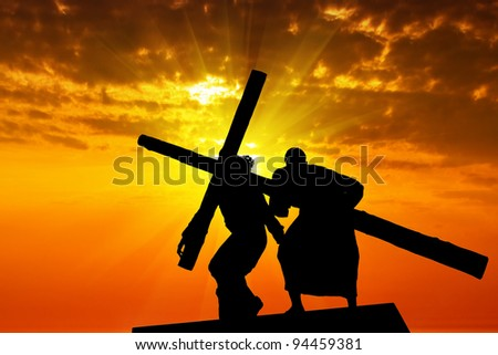 Dragging a wooden cross - stock photo