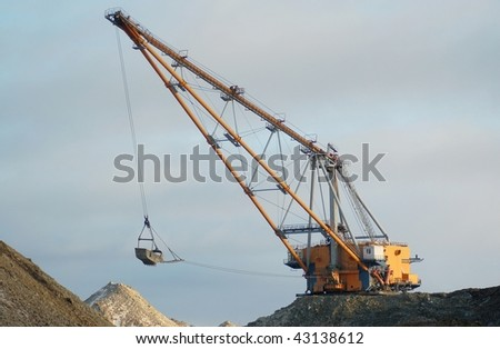 Dragline in open cast mining quarry - stock photo