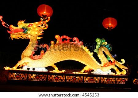 dragon and lanterns at chinese lantern festival celebrating new years - stock photo