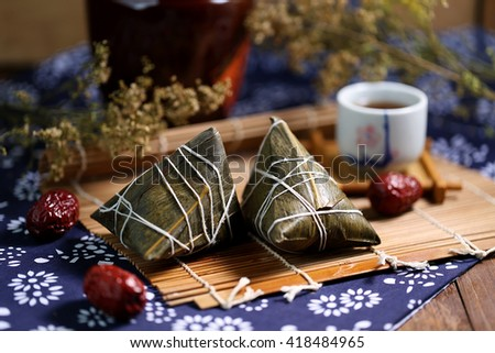 Dragon boat festival dumplings and rice wine - stock photo