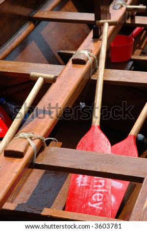 Dragon boat interior with paddlers inside - stock photo