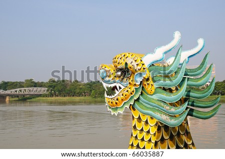 Dragon boat on a river - stock photo