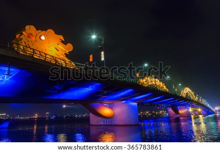 Dragon bridge, DA NANG City, Vietnam, Han River shimmering light at night