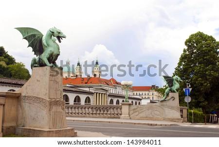 Dragon Bridge view of Cathedral Saint Nicholas on Ljubljanica River Ljubljana Slovenia Europe - stock photo
