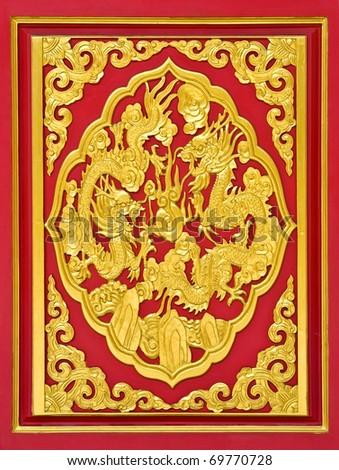 dragon carve gold paint on temple door  in Wat-Leng-Noei-Yi2 at Bang-Bua-Thong, Nonthaburi, Thailand - stock photo