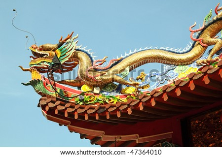 Dragon Design On The Roof Of A Temple - stock photo