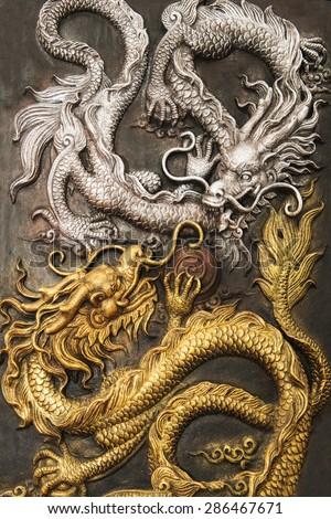 Dragon fighting statue - stock photo