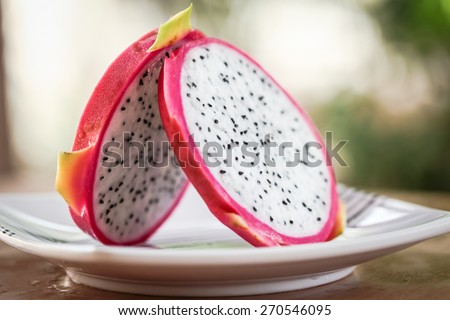 Dragon Fruit in natural light with blurred background effect of trees in the garden. image suitable for restaurants, supermarkets, wholesalers, resellers Dragon Fruit products or health products