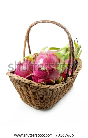 Dragon fruit in the basket isolated on the white background