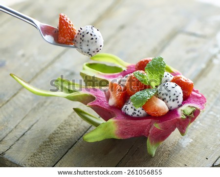 dragon fruit strawberry dessert with fork - stock photo