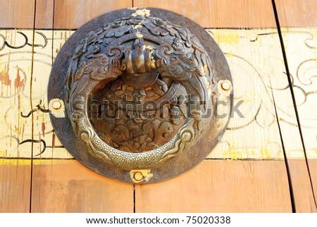 dragon head door  on typically door wooden - stock photo