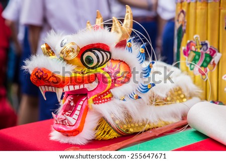 Dragon head on the red table. - stock photo