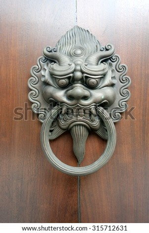 Dragon Head on the temple door at hong kong show on public