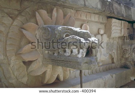 Dragon head relief on ancient Aztec temple at Teotehuacan, Mexico