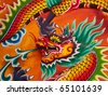 Dragon head sculpture on wall of temple in Thailand - stock photo