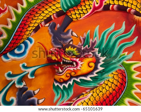 Dragon head sculpture on wall of temple in Thailand