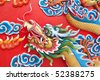 dragon head wall in chinese temple - stock photo