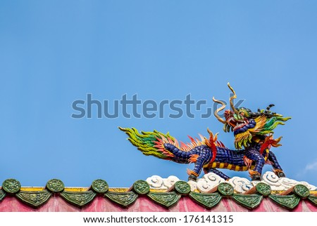Dragon horse statue on the roof in chinese temple, pakchong, Thailand - stock photo
