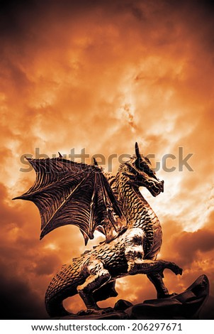 dragon in front of a dramatic sky - stock photo