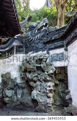 Dragon in the Yu Yuan Garden, Shanghai. The garden is a classical Chinese garden, built during the reign of Ming Emperor Jiajing (1559). - stock photo