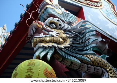 dragon on temple roof - stock photo