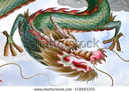 Dragon painting on the glass Of Chinese Temple In Thailand - stock photo