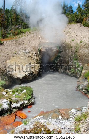 Dragon's Mouth Spring at Yellowstone National Park - stock photo
