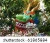 Dragon sculpture among Flowers in garden in Washington DC, USA - stock photo