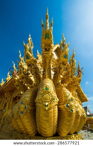 Dragon sculpture at entrance to temple Sri Pan Ton, Province Nan - stock photo