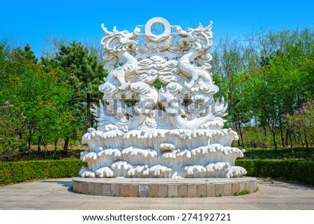 Dragon sculpture. Located in Shenyang Botanical Garden, Shenyang City, Liaoning province, China. - stock photo