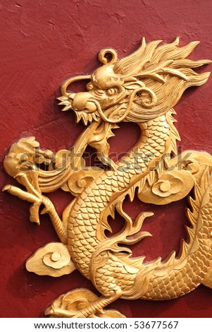 Dragon sculpture on porcelain - stock photo