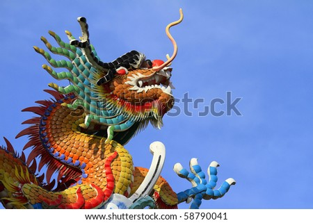 Dragon statue against a backdrop of sky