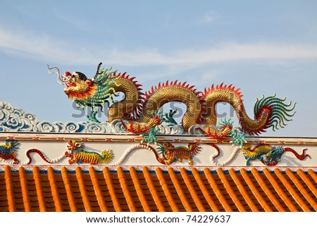 dragon statue at Chinese temple - stock photo