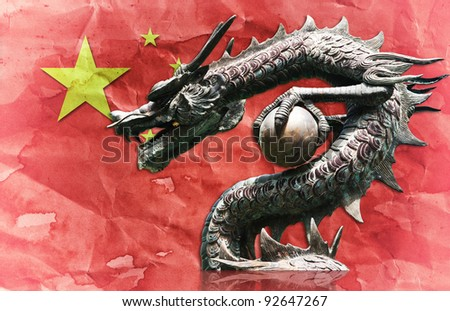Dragon statue on Chinese flag with China day. - stock photo
