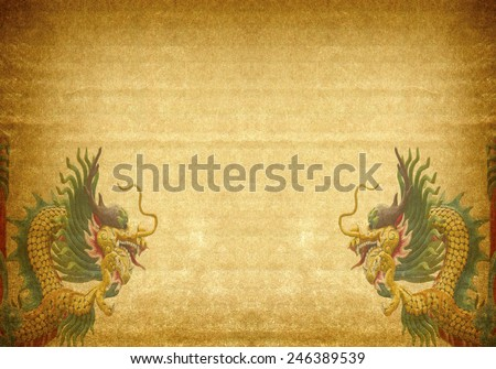 Dragon statue on old paper background