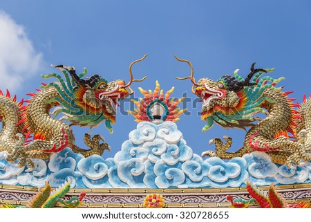 Dragon statue with the blue sky. - stock photo