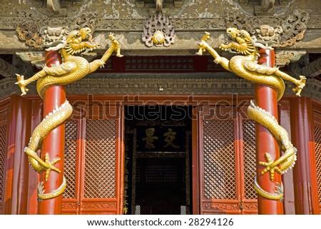 Dragons  entwining around the pillar - stock photo
