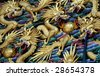 dragons on the wall of an ancient temple in China - stock photo