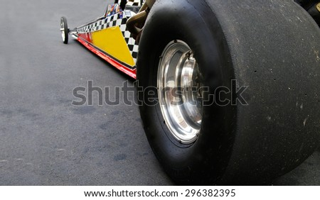 Dragster race car shot from back left tire - stock photo