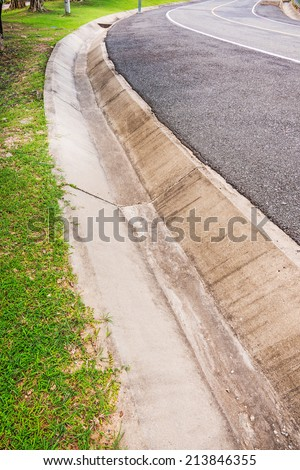 Drain gutter cement beside the road. - stock photo