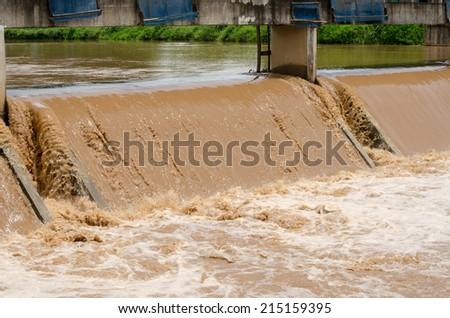 drainage at dam when floods in the rainy season - stock photo