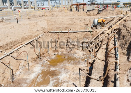 Drainage of excavation - stock photo