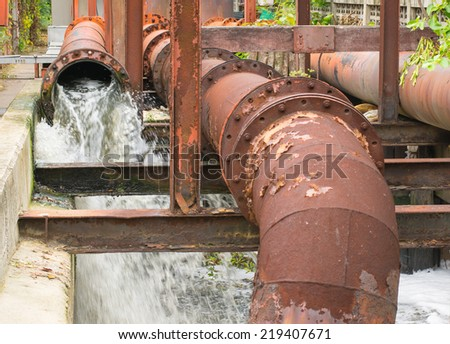 drainage water being pumped from pump station - stock photo