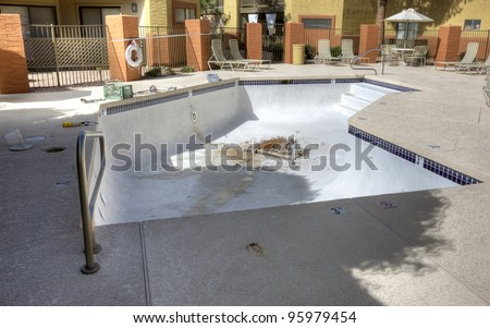 Drained swimming pool under repair - stock photo