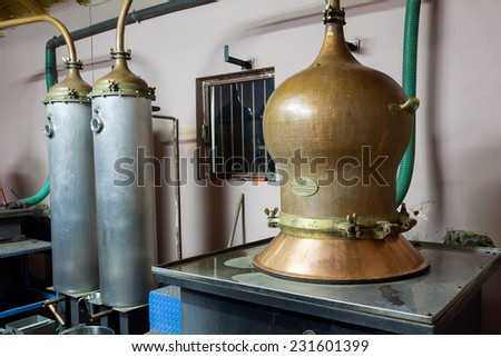 DRAMA, GREECE - NOVEMBER 15,2014: During traditional distillation of alcohol and production of homemade tsipouro/raki