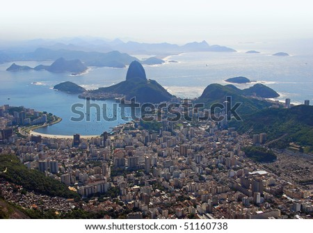 Dramatic aerial view looking back at Rio De Janeiro - stock photo